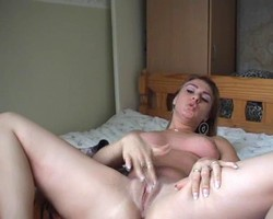 hot chick plays with her pussy